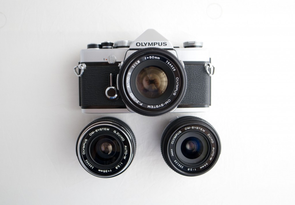Olympus OM-1 SLR film camera with lenses
