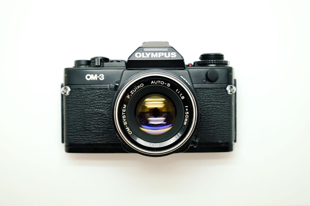 Olympus OM-3 Black SLR film camera with Zuiko 50m lens